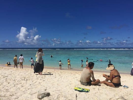 Ritidian beach was busy Saturday despite two people