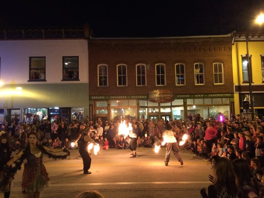 "Fire dancers and folks dressed as zombies performed a pre-show before the annual ""Thriller"" dance on Commercial Street, Oct. 22, 2016. Since beginning in 2010, Springfield's annual tribute to the Michael Jackson pop hit has become a Halloween tradition."