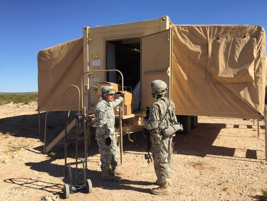 A field kitchen gets set up during the Army Warfighting