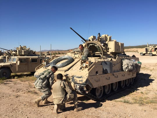 Soldiers do some routine maintenance on their Bradley Fighting Vehicle during the Army Warfighting Assessment in October. Soldiers from 2nd Brigade started training at the AWA for their upcoming rotation at the National Training Center.