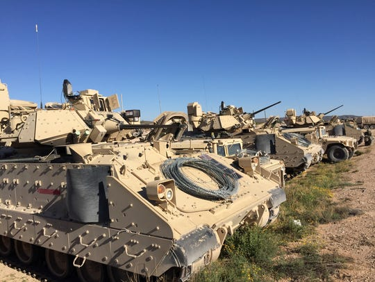 Bradley Fighting Vehicles are lined up during the Army