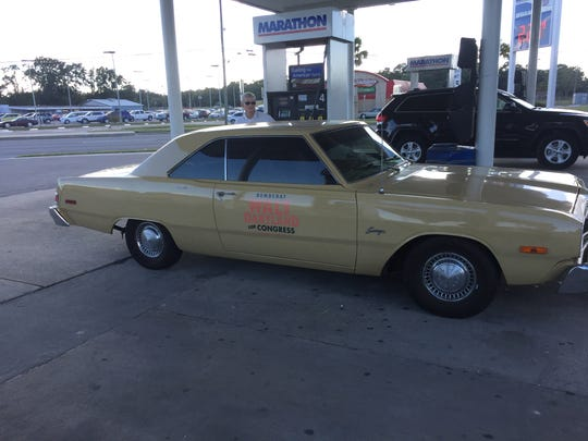 Walt Dartland is criss-crossing the 11,000 square-mile district in a 1976 Dodge Dart. Here he fills up in Dixie County