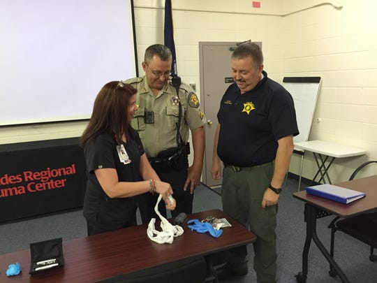 Theresa Hood (left), a nurse and director of education at Rapides Regional Medical Center, demonstrates the use of trauma kits to personnel with the Rapides Parish Sheriff's Office.