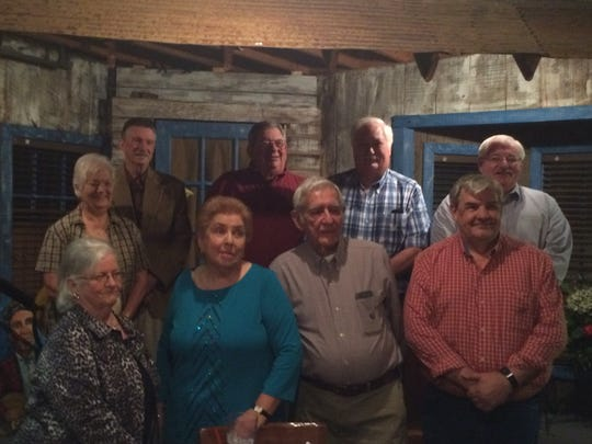Retirees of the Madison County Sheriff's Office pose for a picture Monday in the Old Country Store.