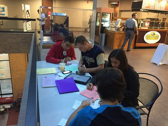 Students from Coronado High School worked on exit poll forms at the County Courthouse Monday.
