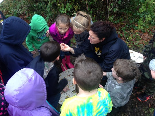 Cascade High School science teacher Molly Gehley instructs students up close during Turner Elementary School's Fall Seasonal Science Day.