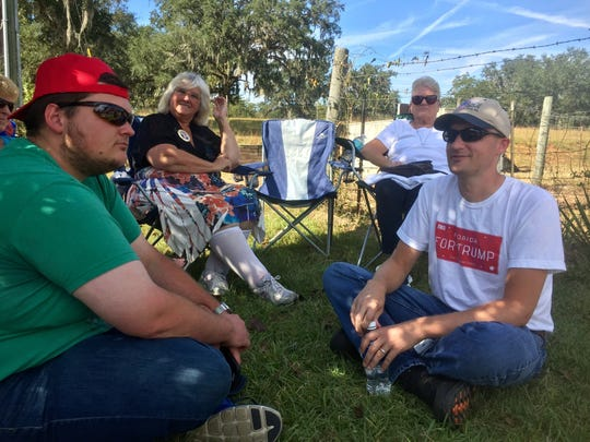 Phillip Wiglesworth of Tallahassee waits with others