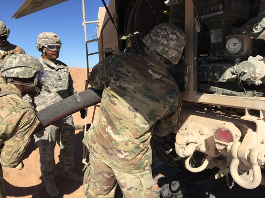 Soldiers from the 504th Composite Supply Company are about to gas up a a fuel tanker.