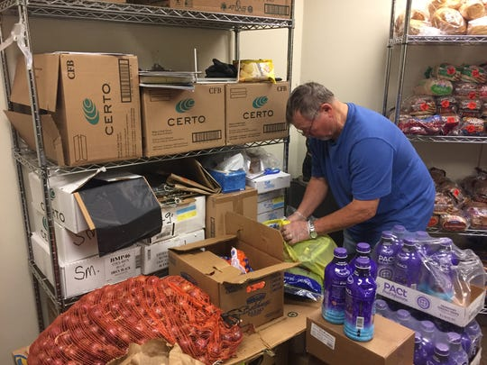 Rich Neidhart, of New City, prepares grocery bags at