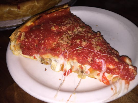 A slice of Union Jack Chicago Style pizza at Wig &