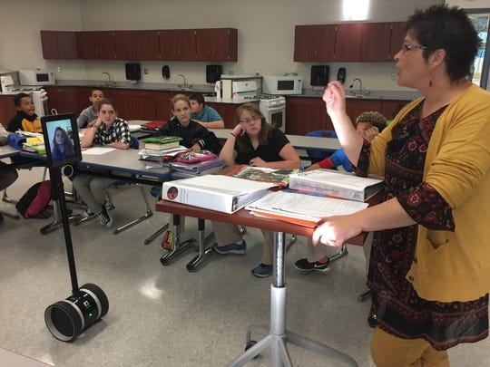 Seventh-grader Madison Conrad uses a robot to participate in a Family and Consumer Science class taught by Kris Bruce at Crestline Middle School.