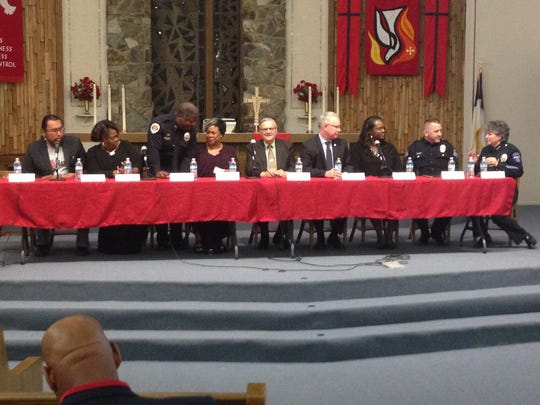 Phoenix-area law enforcement officials and community leaders sit on the panel at Conversation on Cops, a community forum event at a Mesa church.