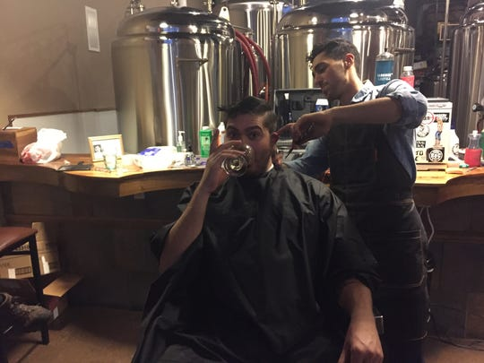 Roc Brewing's Nick Mesrobian gets a shave and a haircut from barber Doriel Pryntz-Nadworny Tuesday at Swiftwater Brewing.