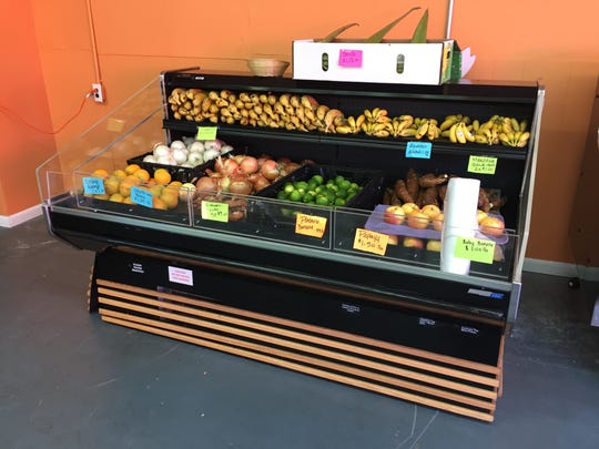 Fresh fruit options at La Esquina Market include different varieties of bananas, limes, onions, oranges, papaya, avocado and apples, among other items.