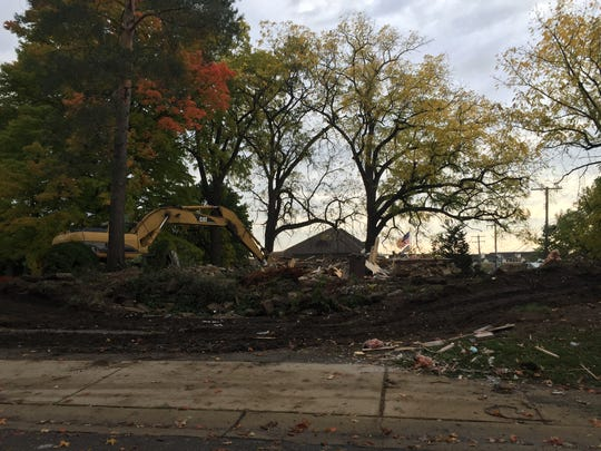 Rubble is left after the razing of the 155-year-old Kellogg House on Ann Arbor Trail. Mature trees were removed from the property as well.