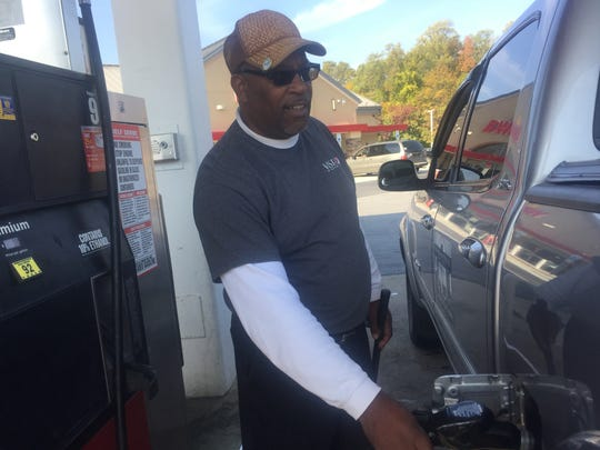 Larry Newman of Bear fills up his 2006 Toyota Tacoma at a Wawa near New Castle.