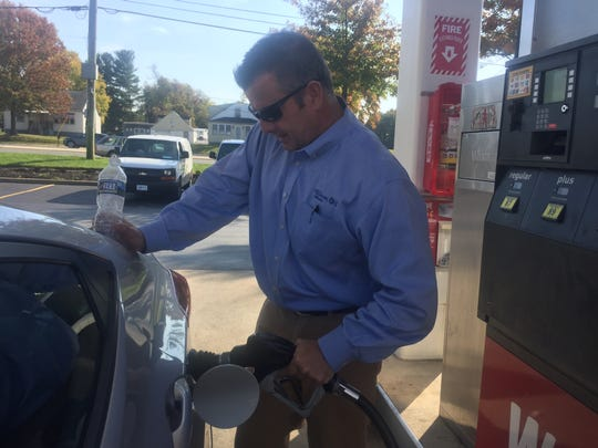 Tom Delgenio of Elkton, Md., pumps gas at a Wawa near New Castle earlier this month.