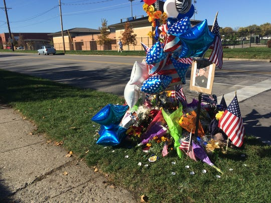 A makeshift memorial sits at the intersection of 70th and Aurora Avenue to remember fallen Urbandale Officer Justin Martin.