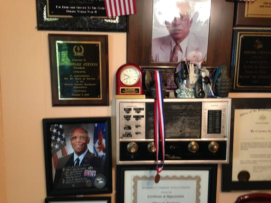 Edward Stevens has a display wall of his wartime mementos. Stevens served in Gen. Patton's 3rd Army during WWII and followed him through many of the milestones of the war including the Battle of the Bulge, Invasion of Normandy and more.