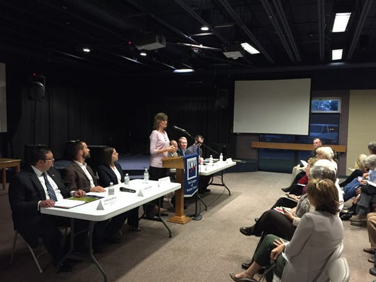 Candidates for District 132 and District 135 sit on the left and right side, respectively, of a moderator Nora Cox's podium Thursday, Nov. 3, 2016, at First Baptist Church. From left, they are Libertarian Chris Burros, Republican Thomas Quinn, Democrat Crystal Quade, Democrat Randy Alberhasky, Republican Steve Helms and Libertarian David Carr.