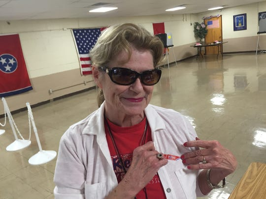 """Brenda Tippit proudly her """"I voted"""" sticker after voting"""