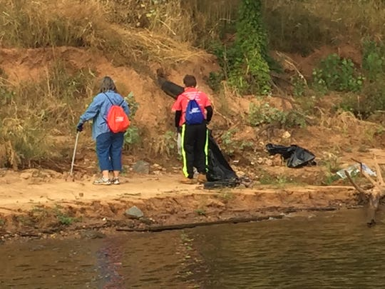 Volunteers flanked the banks of Red River Saturday