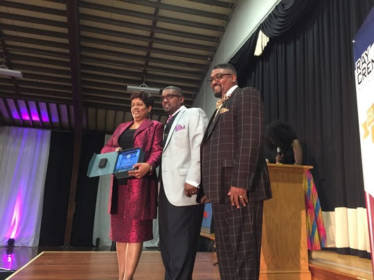 Members of the Bible Tabernacle Christian Center accept the Ray Crenshaw neighborhood award for best church choir Saturday night at the Voni Grimes gym in York.