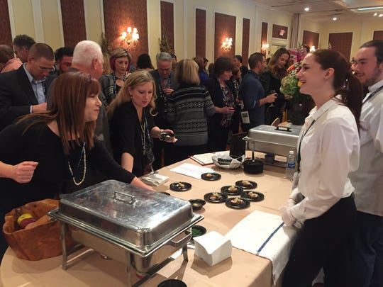 Participants in Taste of the Hudson Valley approach the table belonging to The Artist's Palate. The restaurant served, among other things, matzo ball soup and pork tenderloin.
