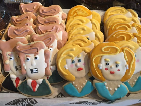 Sugar cookies decorated like Donald Trump and Hillary