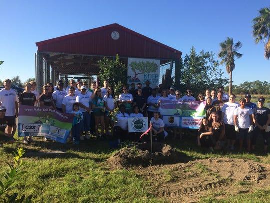 Volunteers planted trees at Egret Marsh Stormwater Park.