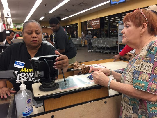 Kroger associate Joyce Banks assisted Caroline Darden