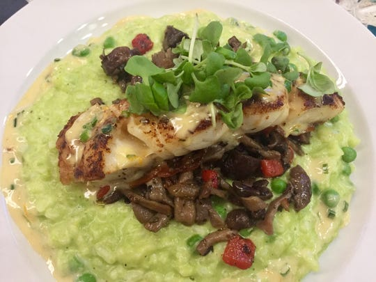 Black grouper with English pea risotto, mushroom ragout and citrus buerre blanc at Latitude 26