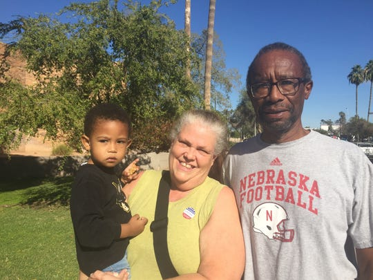 Connie and James Neal vote in Tempe with their grandson