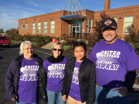 Violet Layman, Teresa Tomey, Abigail Layman and Barry Tomey, non-party-affiliated volunteers from Cornerstone Church of Augusta were at the Wayne Hills Elementary polls giving out free coffee and water and thanking people for voting on Tuesday, Nov. 8, 2016, in Waynesboro, Va.