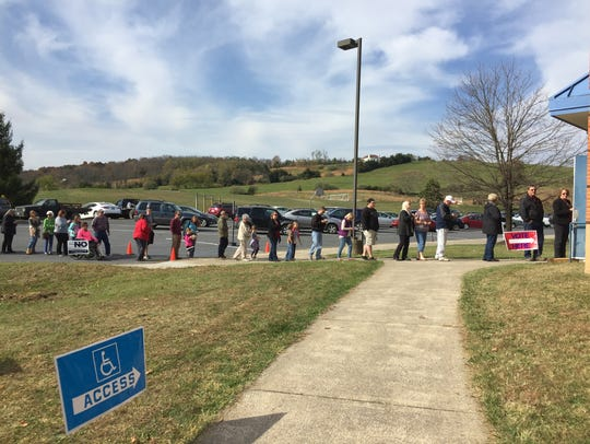 A long line of voters wait outside the polls at Clymore