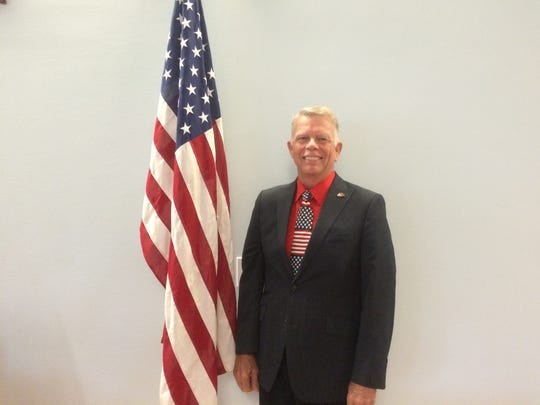 County Commissioner Rick Bacon shows off his patriotic