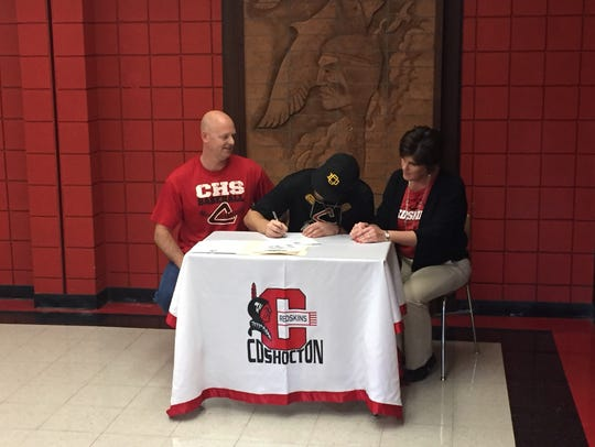 Andrew Mason signs his letter of intent to play baseball