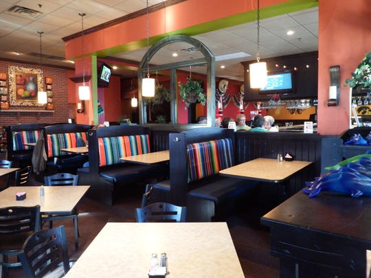 The interior of Avocado Mexican Bar and Grille in the