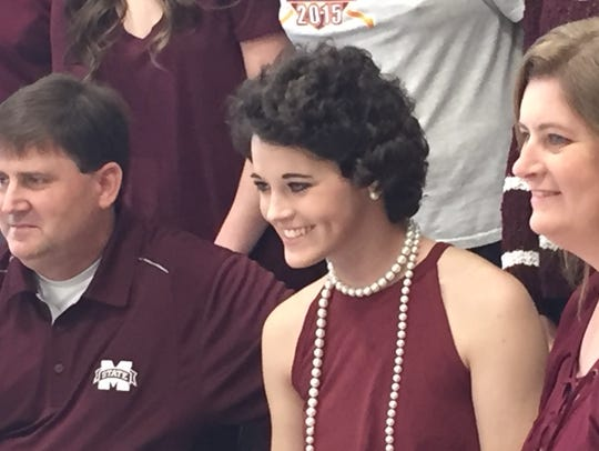 Brantley's Alex Wilcox and her parents after she signed with Mississippi State softball in November 2016.