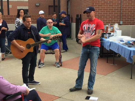 Country music artist Ryan Weaver, left, is accompanied by guitarist Craig Wilson as the two perform for residents of the Tennessee Veterans Home in Murfreesboro on Election Day.
