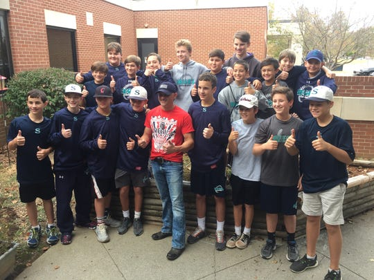 Rising country star Ryan Weaver, center, stands with members of the Siegel Middle School baseball team at a fall party at the Tennessee Veterans Home, where Weaver performed.
