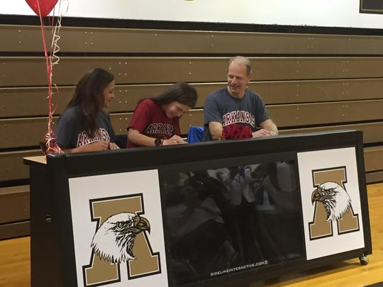 Dana, left, and her husband, Ferral Endsley, joined daughter Ashton at her scholarship signing to the University of Arkansas. The parents met in Arkansas.