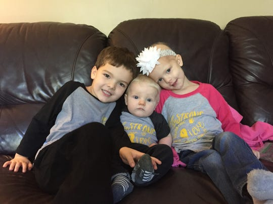 Lily Bowen, 3, right sits with her brothers, Eli, 5, and Greyson, 6 months. A bowling and silent auction fundraiser will be held Sunday, Nov. 20, from 2 to 6 p.m. at the Royal Scot Golf & Bowl.