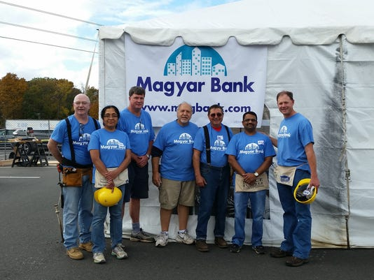 New Brunswick: Magyar Bank volunteers help build home for Raritan Valley Habitat For Humanity