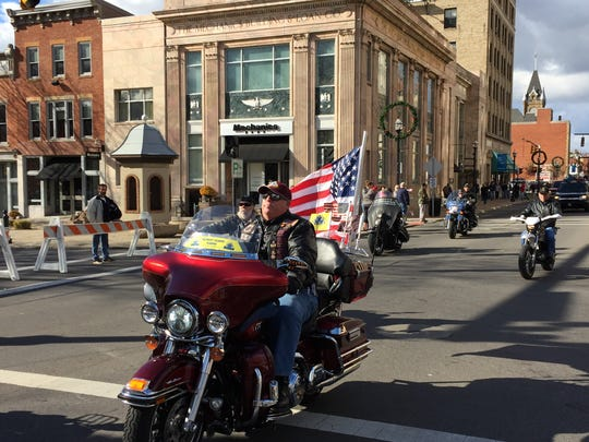 Gary Knight of Ontario, District 2 Captain for the Patriot Guard Riders, rides in the Veterans Day Parade in Mansfield.