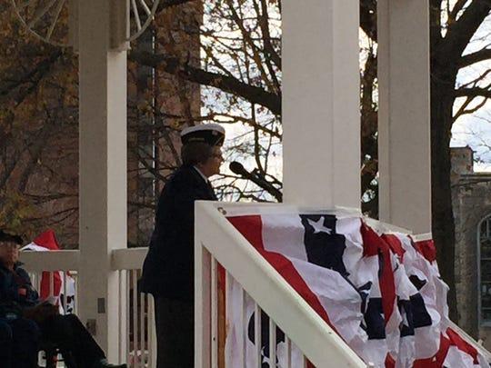 Retired U.S. Air Force Lt. Molly Doss speaks.