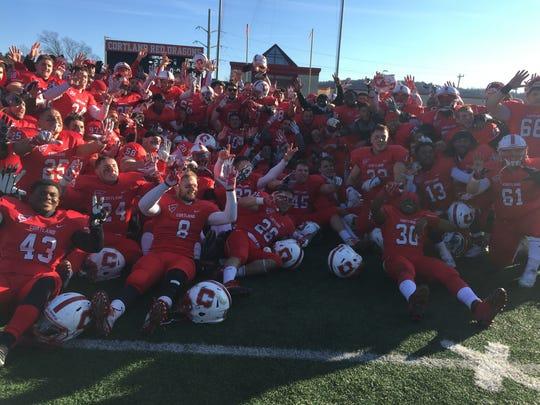 Cortland players pose after winning the Cortaca Jug