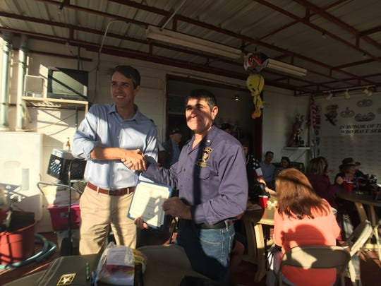 U.S. Rep. Beto O'Rourke presents a certificate to Darrell