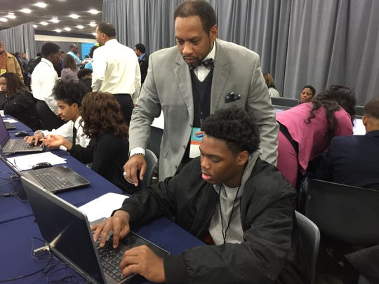 Detroiter Titus Banks, 17, works on his resume with help from consultant David Solomon.