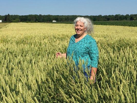 636147141954332254-636143986628382881-Deirdre-in-a-field-of-waxy-wheat.jpg